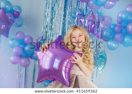 Portrait of Pretty little girl sits with color balloons (star) - stock photo
