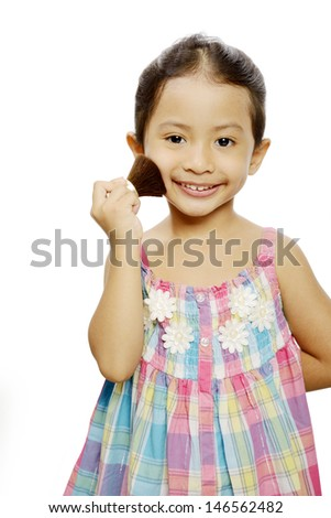 Portrait of pretty little girl with makeup isolated on white background