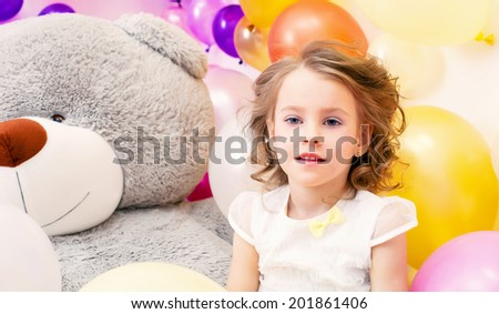 Portrait of pretty little lady with big plush bear - stock photo