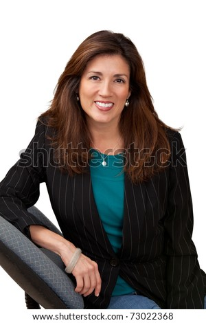Portrait of pretty mature businesswoman wearing black jacket and blue blouse. Isolated on white sitting in chair. - stock photo