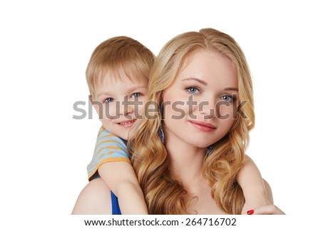Portrait of pretty mother and son posing at camera - stock photo
