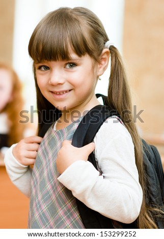 portrait of pretty preschool girl with backpack - stock photo