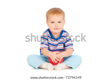 portrait of pretty small boy with red ball
