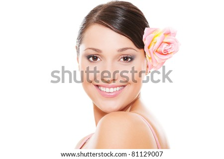portrait of pretty smiley model with rose in hair. isolated on white background