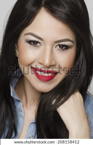 Portrait of pretty smiling young woman head shot photo - stock photo