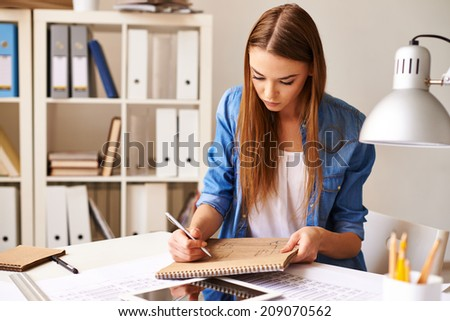 Portrait of pretty student making sketch at lesson - stock photo