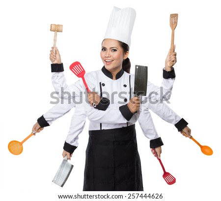 portrait of Pretty woman Chef in action with 8 arm ready to cook - stock photo