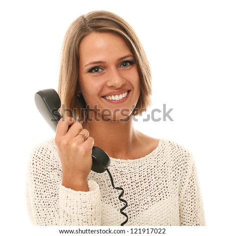 Portrait of pretty woman holding old handset - stock photo