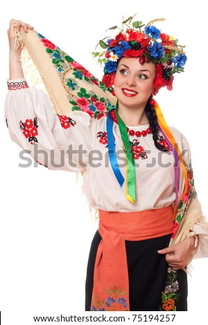 Portrait of pretty woman in the Ukrainian national clothes - stock photo
