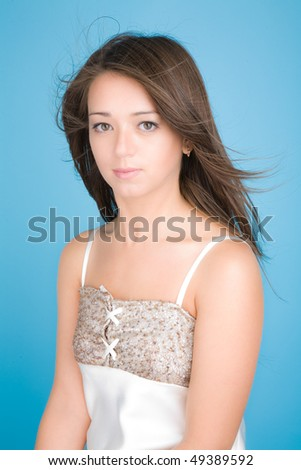 Portrait of pretty woman on blue background - stock photo