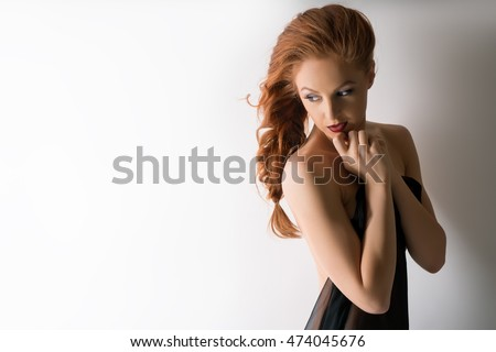 Portrait of pretty woman presses her hands to face