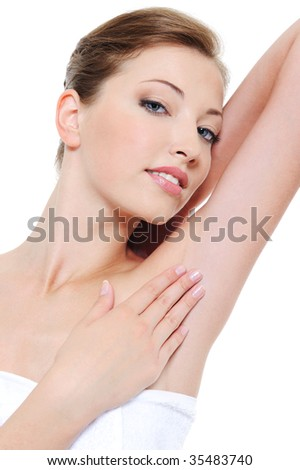 Portrait of pretty woman stroking her clean fresh armpit - stock photo