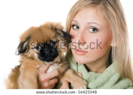 Portrait of pretty woman with a pekinese puppy. Isolated