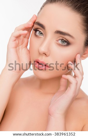 Portrait of pretty woman with beautiful skin touching her face - stock photo