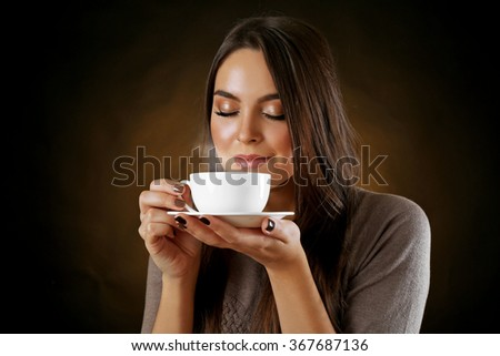 Portrait of pretty woman with cup of coffee