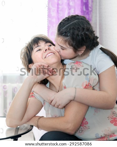 Portrait of   pretty woman with her  teenager daughter - stock photo