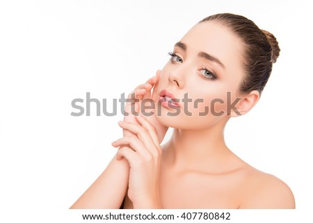 Portrait of pretty woman with perfect skin touching her face - stock photo