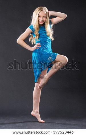 Portrait of pretty young blonde dancer - stock photo