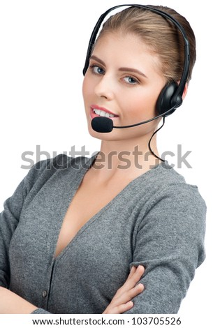 Portrait of  pretty young female call center employee wearing a headset, against white background - stock photo