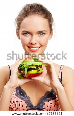 Portrait of pretty young girl with vegetable burger in hands - stock photo