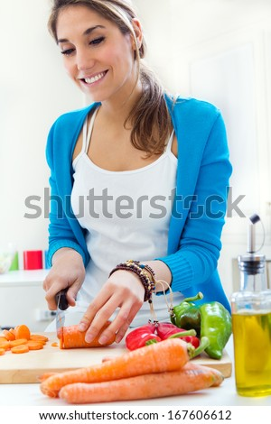 Portrait of Pretty young woman cooking at home