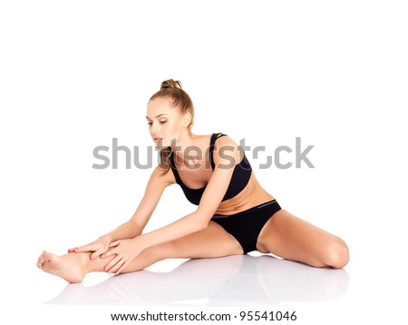 Portrait of pretty young woman doing fitness - stock photo