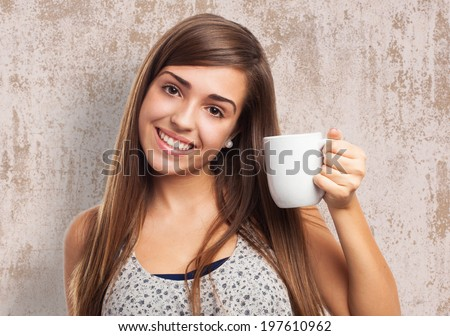 portrait of pretty young woman holding a coffee cup