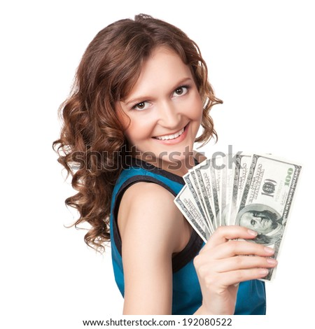 Portrait of pretty young woman holding a fan of dollar bills on white background