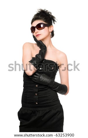 Portrait of pretty young woman in a black dress. Isolated