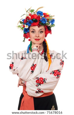 Portrait of pretty young woman in the Ukrainian national clothes - stock photo