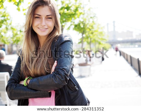 Portrait of pretty young woman. Looking at the Camera. - stock photo