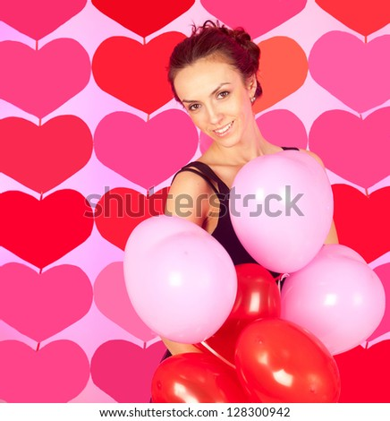 Portrait of pretty young woman over heart-made background, love concept - stock photo