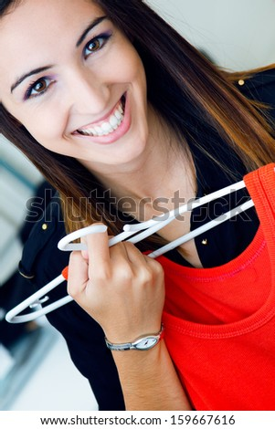 Portrait of pretty young woman shopping for clothes - stock photo