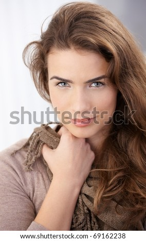 Portrait of pretty young woman smiling at home.? - stock photo