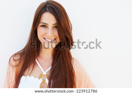 Portrait Of Pretty Young Woman Standing By Wall