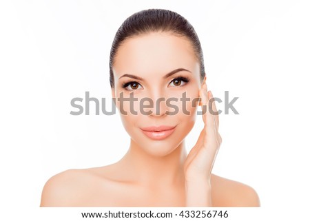 Portrait of pretty young woman touching her face - stock photo