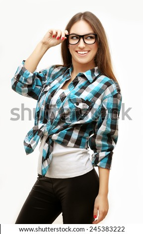 Portrait of pretty young woman wearing blue shirt, laughing at camera. Gray background - stock photo