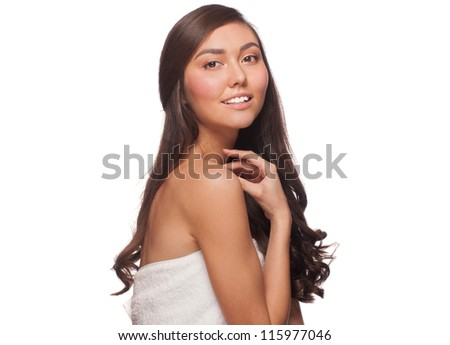 Portrait of pretty young woman with beautiful healthy skin and long brown hair. Isolated on white background - stock photo