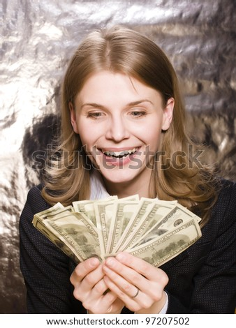 portrait of pretty young woman with money