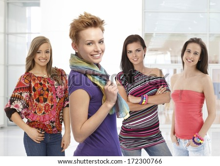 Portrait of pretty young women in colorful clothes. - stock photo