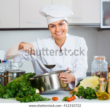 Portrait of professional chef with vegetables and herbs
