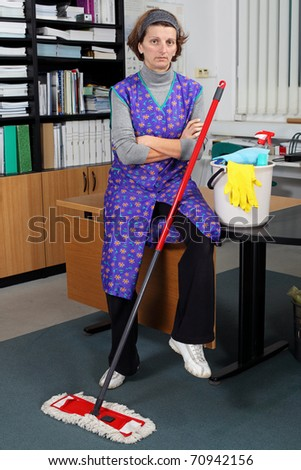 Portrait of professional cleaning lady. - stock photo