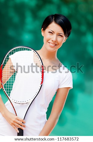 Portrait of professional tennis player with racket at the tennis court