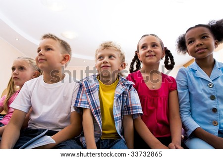 Portrait of pupils looking at lecturer during lesson with attention - stock photo