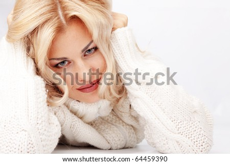 Portrait of pure beautiful woman wearing winter warm clothing over white