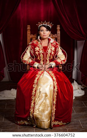 Portrait of Queen in a medieval castle - stock photo