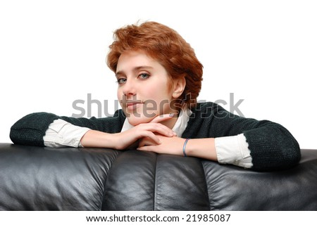 Portrait of red-haired girl near sofa isolated over white background - stock photo