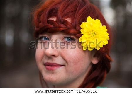 Portrait of red-haired girl on   street