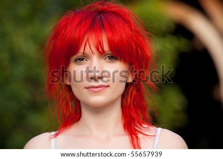 Portrait of redhead woman looking at camera