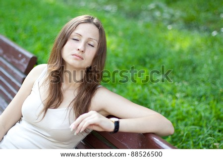 Portrait of relaxed brunette girl on green background
